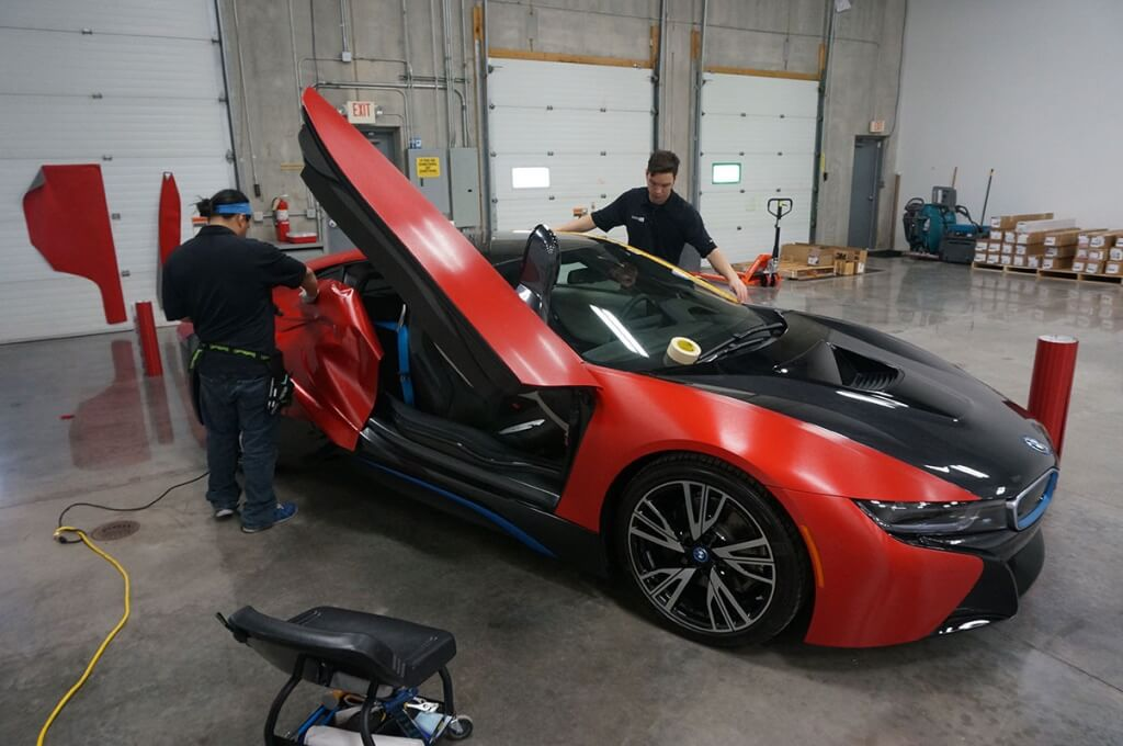 Brand Ink Applying a BMW i8 Vehicle Wrap in Shop