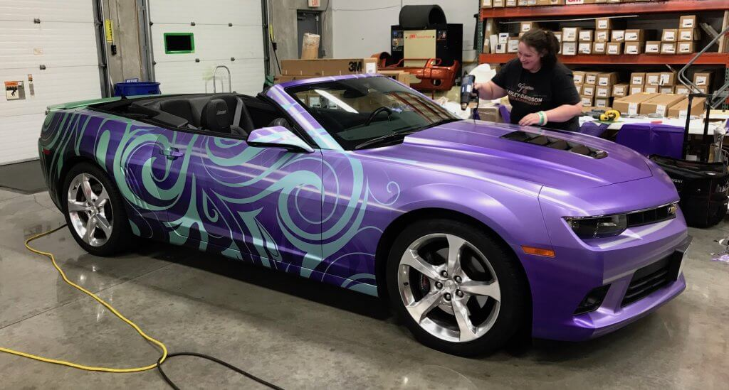 Brand Ink applying heat to set a vehicle wrap